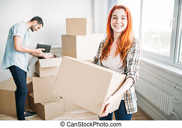 Happy couple moving to new house