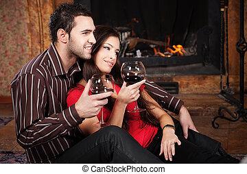 Happy couple near fireplace