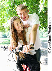 Happy couple on a bicycle