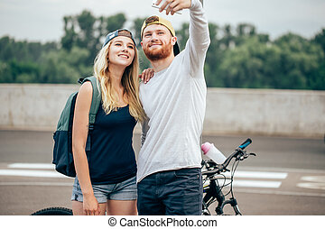 Happy couple on a bike ride in the countryside
