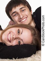 happy couple on a carpet