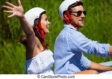 Happy couple on a scooter