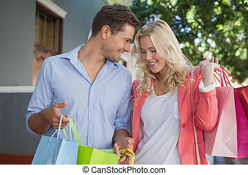 Happy couple on a shopping trip