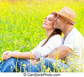 Happy couple on floral field