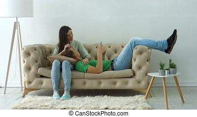 Happy couple on sofa enjoying leisure at home