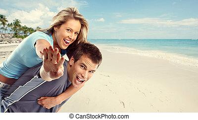 Happy couple on the beach.