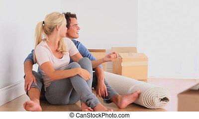 Happy couple on the floor