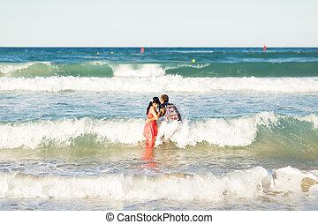 happy couple on the sea