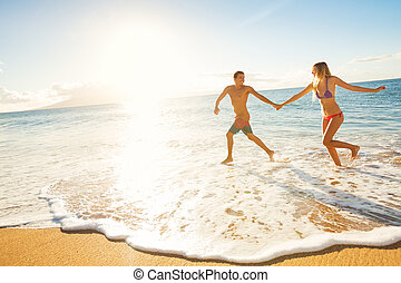 Happy Couple on Tropical Beach at Sunset - Happy Couple...
