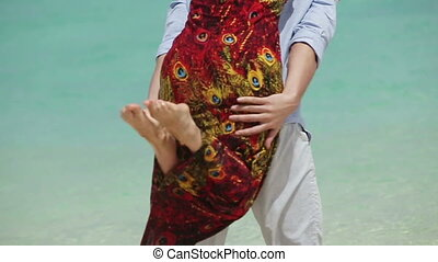 Happy couple on tropical beach