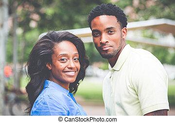 Happy couple outside - Closeup portrait of a young couple,...