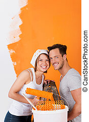 Happy couple painting their flat - Happy couple having fun ...
