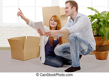 Happy couple planning decor in new home