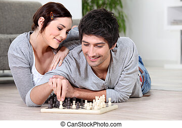 happy couple playing chess