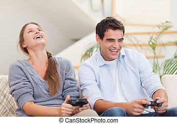 Happy couple playing video games