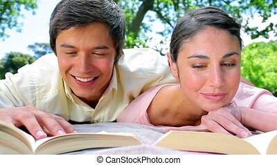 Happy couple reading novels together