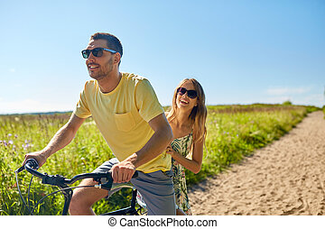 happy couple riding bicycle together in summer - people,...