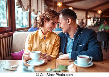 Happy couple, romantic date in restaurant