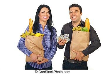 Happy couple shopping food with money