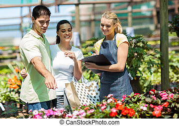 happy couple shopping for plants