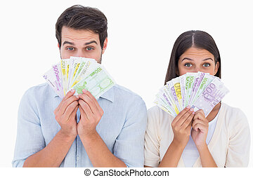 Happy couple showing their money