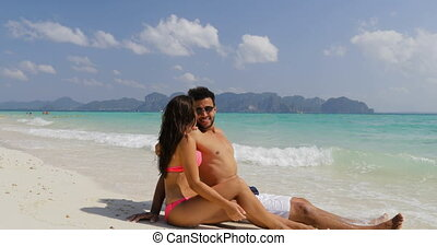 Happy couple Sit On Sand Beach Talking, Man And Woman In...