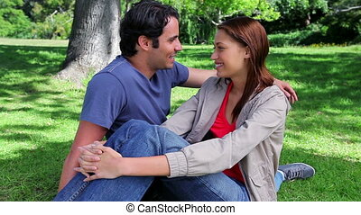 Happy couple sitting on the grass