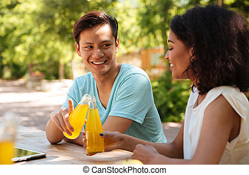 Happy couple sitting outdoor