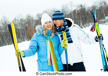 happy couple skiing
