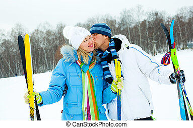 happy couple skiing - happy young couple going skiing on a...
