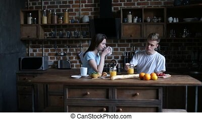 Happy couple spending morning together in kitchen