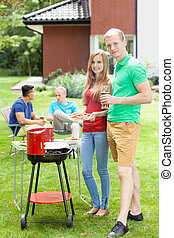 Happy couple supporting grill