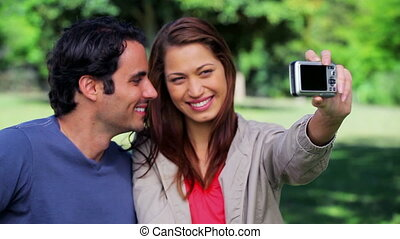 Happy couple taking a picture of themselves in the...