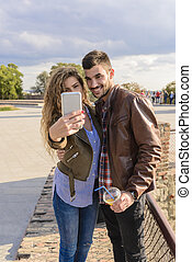 Happy couple taking a selfie photos
