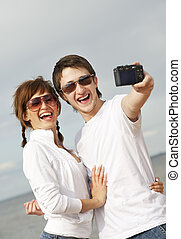 Happy couple taking a selfshoot picture