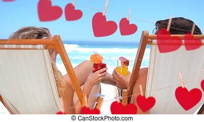 Happy couple toasting on beach