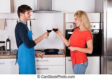 Happy Couple Toasting Wine In Kitchen