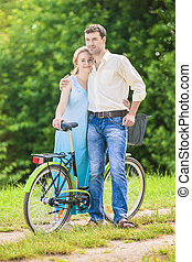 Happy Couple Together with Bicycle. Positive Expression