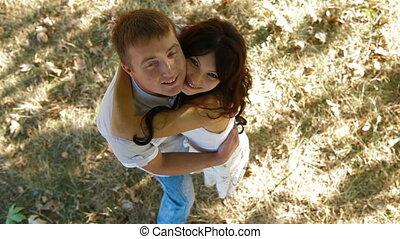 Happy couple under tree