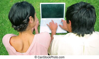 Happy couple using a laptop