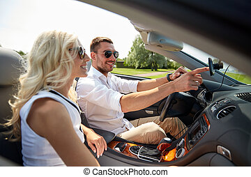 happy couple using gps navigation system in car