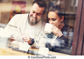 Happy couple using tablet