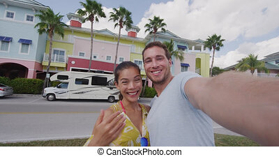 Happy couple video selfie on motorhome RV travel vacation in...