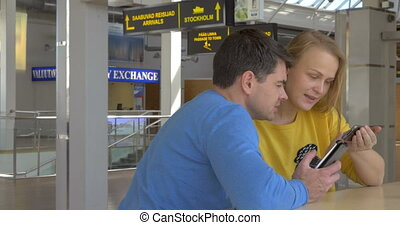 Happy Couple View Photos In Smart Phone