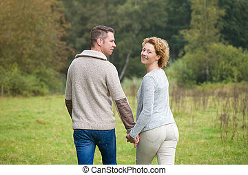 Happy couple walking in the countryside