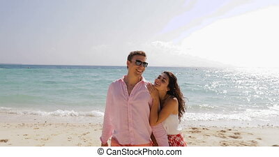 Happy couple Walking On Beach Holding Hands, Smiling Man And...