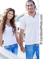 Happy couple walking on footbridge