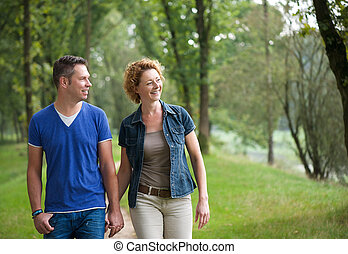 Happy couple walking together outdoors