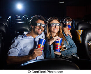 Happy Couple Watching 3D Movie In Theater