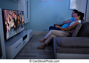 Happy Couple Watching Film Together